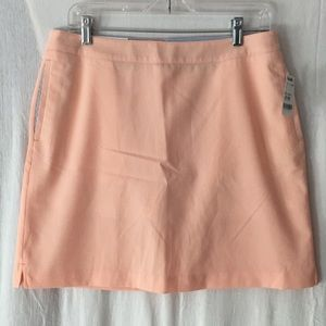 Orange Greg Norman golf skirt